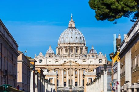 Tourism and sightseeing, view over famous St. Peter's Basilica, Vatican City from Road of the Conciliation, summer day, blue sky